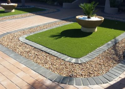 Artificial Grass, Paving and Pebble Designed Garden