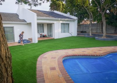 Artificial Grass enhancing the brick paving