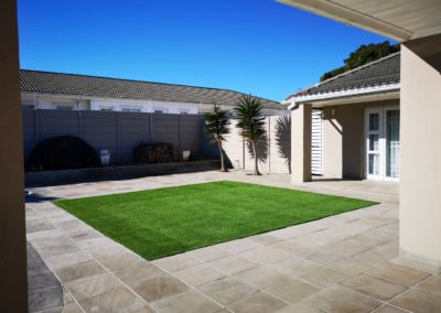 Artificial Grass with Sandstone Pavers