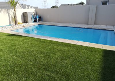 Pool Paving with Artificial Grass Lawn